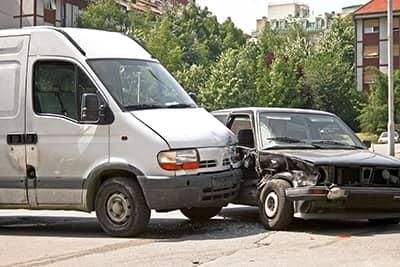 A t-bone crash involving a transport van and a car
